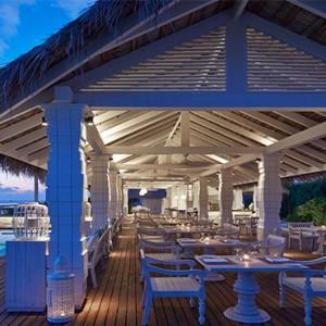 Loama Resort Maldives at Maamigili - Luxury Maldives Honeymoon packages - Iru cafe at dusk