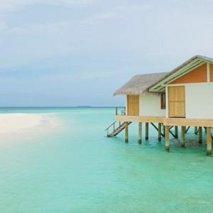 Loama Resort Maldives at Maamigili - Luxury Maldives Honeymoon packages - Ocean villa at daynight