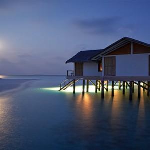 Loama Resort Maldives at Maamigili - Luxury Maldives Honeymoon packages - Ocean villa at night