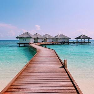 Loama Resort Maldives at Maamigili - Luxury Maldives Honeymoon packages - Overwater jetty