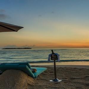 Loama Resort Maldives at Maamigili - Luxury Maldives Honeymoon packages - Sandbank at dawn
