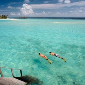 Loama Resort Maldives at Maamigili - Luxury Maldives Honeymoon packages - Snorkelling