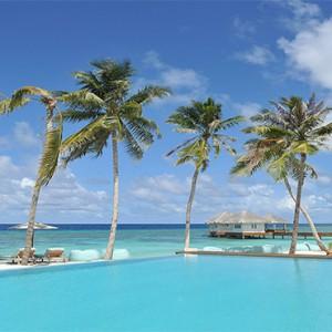 Loama Resort Maldives at Maamigili - Luxury Maldives Honeymoon packages - infinity pool at day
