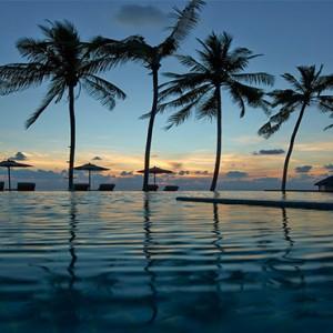 Loama Resort Maldives at Maamigili - Luxury Maldives Honeymoon packages - infinity pool at dusk