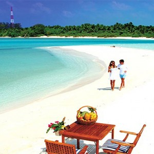 Nika Island Resort and Spa - Luxury Maldives Honeymoon Packages - dining on beach