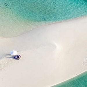 Soneva Jani - Maldives Luxury Honeymoon packages - sandbank dining