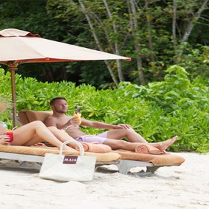 MAIA Luxury Resort and Spa - Luxury Seychelles Honeymoon Packages - couple on the beach