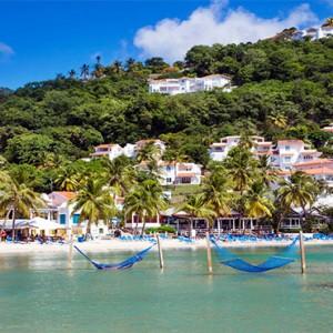 Windjammer Landing Villa Beach resort - Luxury Honeymoon St Lucia - hammocks in ocean