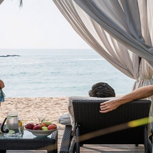 Anantara Peace Haven Tangalle Resort - Luxury Sri Lanka Honeymoon packages - couple by the cabana