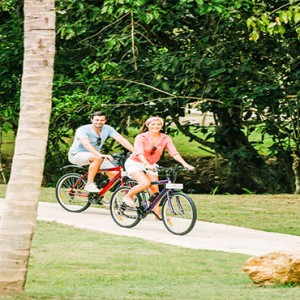 Anantara Peace Haven Tangalle Resort - Luxury Sri Lanka Honeymoon packages - couples on a bike ride