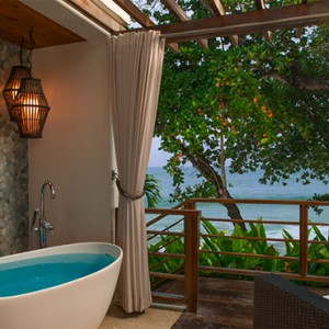 Oceanfront Two-Story One Bedroom Butler Villa Suite with Balcony Tranquility Soaking Tub - sandals regency la toc - luxury st lucia honeymoons