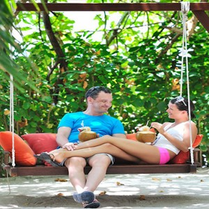 Bandos Maldives - Luxury Maldives honeymoon packages - couple relaxing