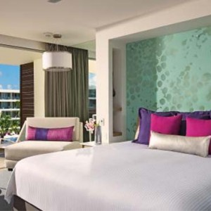 Breathless Riviera Cancun resort and spa - Luxury Mexico Honeymoon packages - Allure Junior Suite bedroom