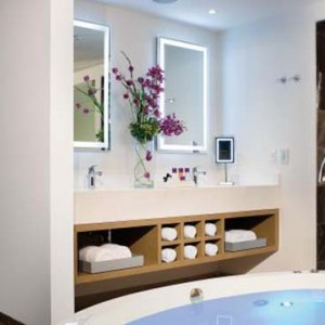 Breathless Riviera Cancun resort and spa - Luxury Mexico Honeymoon packages - Xhale Club master Suite bathroom