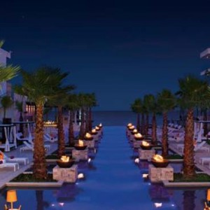 Breathless Riviera Cancun resort and spa - Luxury Mexico Honeymoon packages - pool at night