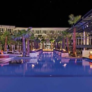 Breathless Riviera Cancun resort and spa - Luxury Mexico Honeymoon packages - pool at night1
