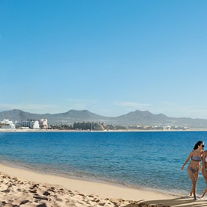 Couple on the beach - Breathless Cabos San Lucas - Luxury Mexico Honeymoon Packages