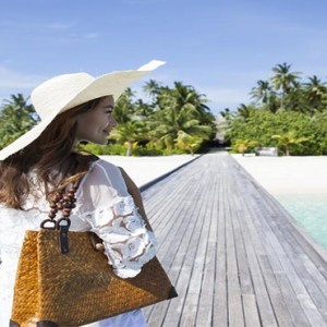 Outrigger Konotta Maldives Resort - Luxury Maldives Honeymoon Packages - Walking on the jetty