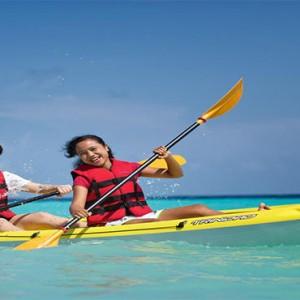Outrigger Konotta Maldives Resort - Luxury Maldives Honeymoon Packages - paddling