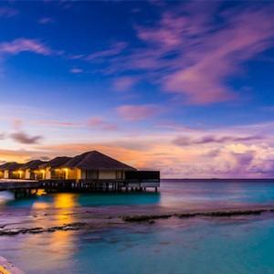 Outrigger Konotta Maldives Resort - Luxury Maldives Honeymoon Packages - villa exterior at sunset