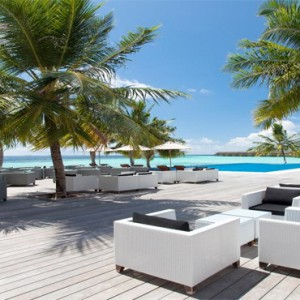 Vilamendhoo Island resort and spa - Luxury Maldives Honeymoon Packages - sunset bar pool