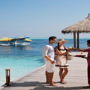Vilamendhoo Island resort and spa - Luxury Maldives Honeymoon Packages - welcome on the jetty