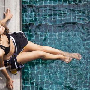 Woman In Pool Outrigger Konotta Maldives Resort Maldives Honeymoons