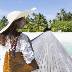 Woman On Jetty Outrigger Konotta Maldives Resort Maldives Honeymoons