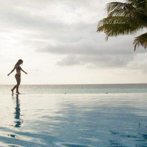 Women Walking By Pool Outrigger Konotta Maldives Resort Maldives Honeymoons