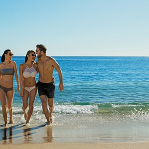 friends on the beach - Breathless Cabos San Lucas - Luxury Mexico Honeymoon Packages
