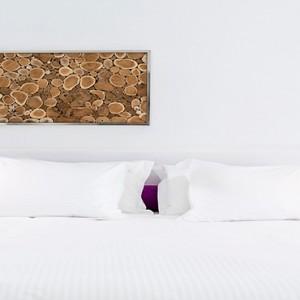 Charisma Suites Santorini - Luxury Greece Honeymoon packages - Senior suites bed