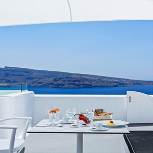 Charisma Suites Santorini - Luxury Greece Honeymoon packages - breakfast with a view