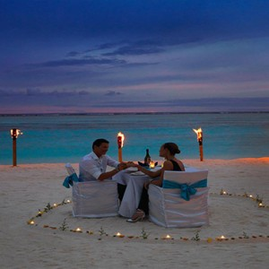 Cocoon Maldives - Luxury Maldives Honeymoon Packages - private dining on beach