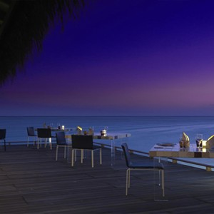 Cocoon Maldives - Luxury Maldives Honeymoon Packages - restauant at sunset