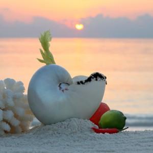 sunset - st regis maldives vommuli - luxury maldives holidays