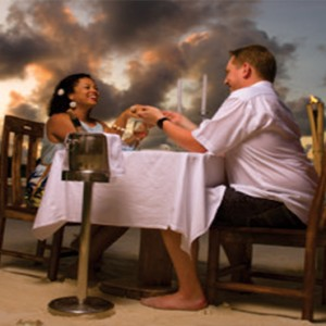 Acajou Beach Resort - Luxury Seychelles Honeymoon Packages - Romantic dining on the beach