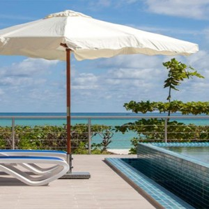 Acajou Beach Resort - Luxury Seychelles Honeymoon Packages - relax by the pool