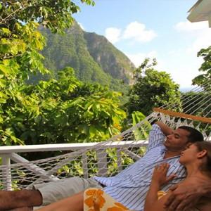 Southfield Estate Resort - Luxury St Lucia honeymoon Packages - Couple relaxing in hammock