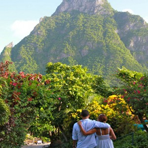 Southfield Estate Resort - Luxury St Lucia honeymoon Packages - couple touring piton mountains