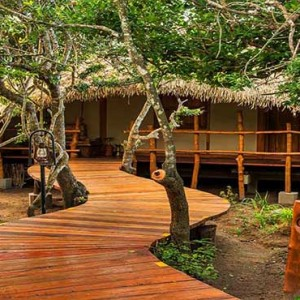 Uga Chena Huts Yala - Luxury Sri Lanka Honeymoon packages - cabin exterior walkway