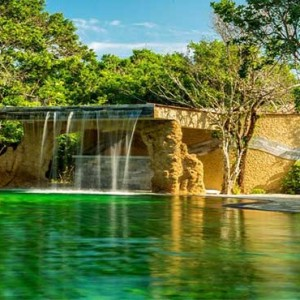Uga Chena Huts Yala - Luxury Sri Lanka Honeymoon packages - waterfall in the pool