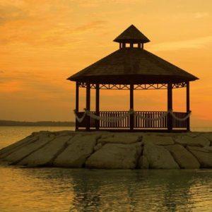 Jamaica Honeymoon Packages Secrets St James Montego Bay Wedding Couple Gazebo At Sunset