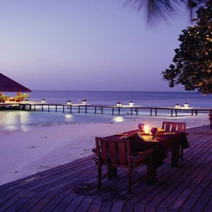 Angsana Ihuru Island - Luxury Maldives Honeymoon Packages - restaurant view at night