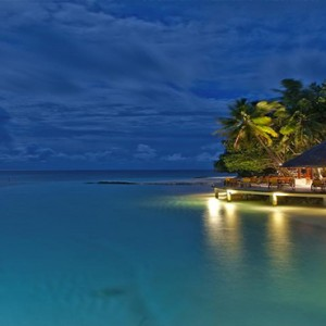 Angsana Ihuru Island - Luxury Maldives Honeymoon Packages - restaurant view at night1