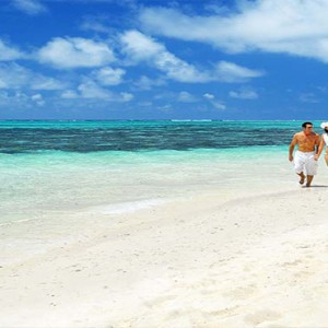 Astroea beach - Luxury Mauritius Honeymoon Packages - Couple walking on beach