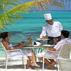 Astroea beach - Luxury Mauritius Honeymoon Packages - Etolie de mer restaurant couple dining1