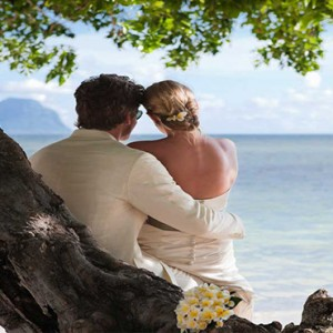 Maradiva Villas Resort & Spa - Luxury Mauritius Honeymoon Packages - Beach wedding couple