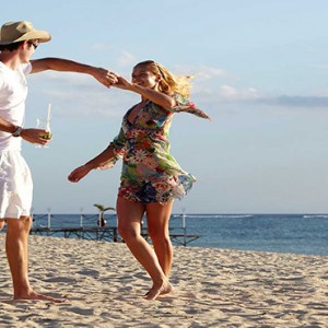 Maradiva Villas Resort & Spa - Luxury Mauritius Honeymoon Packages - Couple dancing on beach