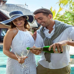 Maradiva Villas Resort & Spa - Luxury Mauritius Honeymoon Packages - Couple enjoying Champagne
