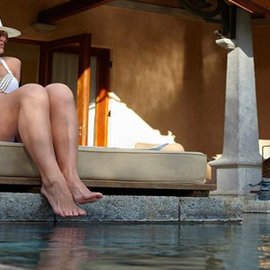 Maradiva Villas Resort & Spa - Luxury Mauritius Honeymoon Packages - Luxury Suite Pool Villas woman sitting by the pool